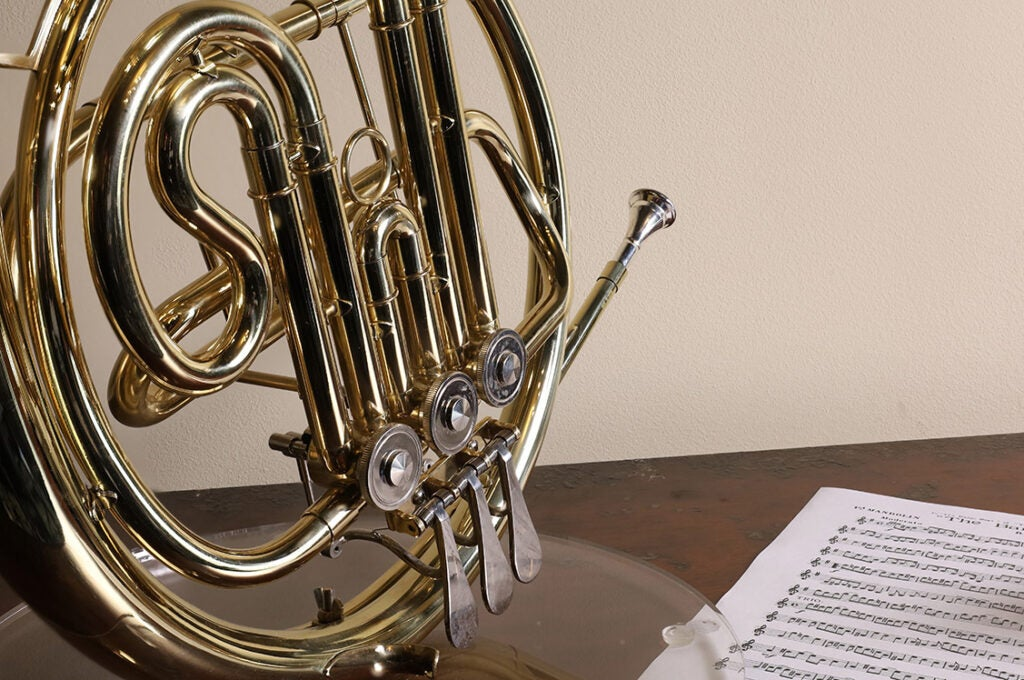 french horn and sheet music