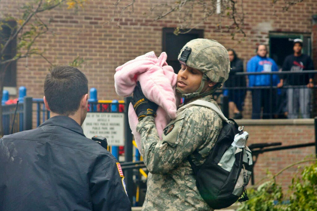 A National Guard soldier holds a baby displaced by Hurricane Sandy in Hoboken, NJ, October 31, 2012.
