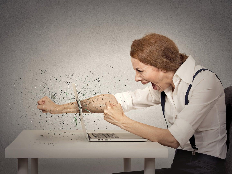 A woman punching through a laptop screen