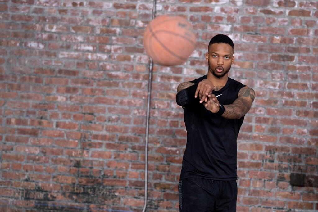 basketball player throwing ball