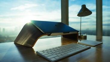 Laptop propped up on desk