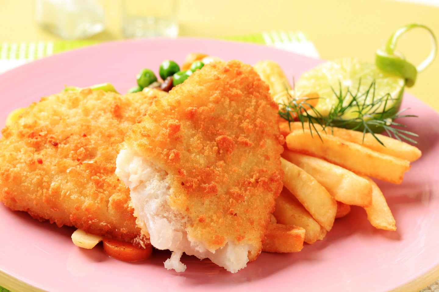 a plate of fried fish and french fries