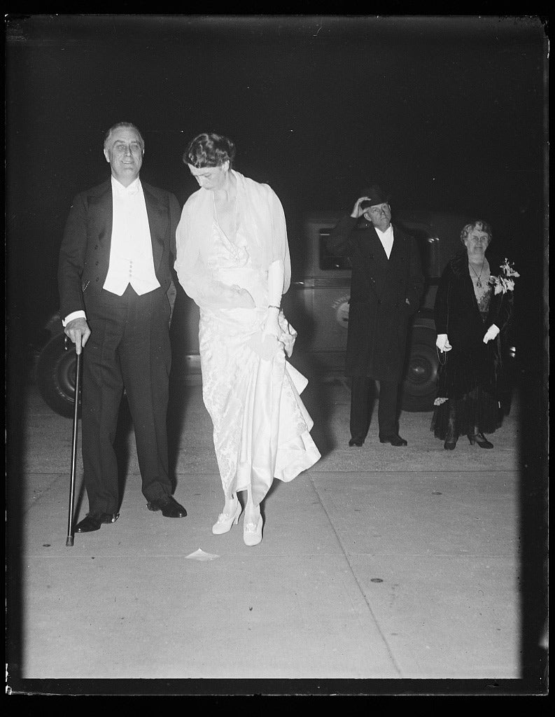 Franklin Roosevelt (standing with cane) and Eleanor Roosevelt