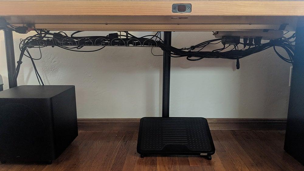 bundling cords up off the floor beneath desk