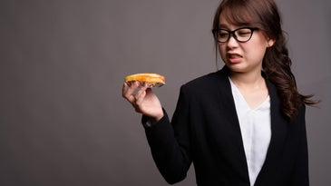 grimacing at a hotdog