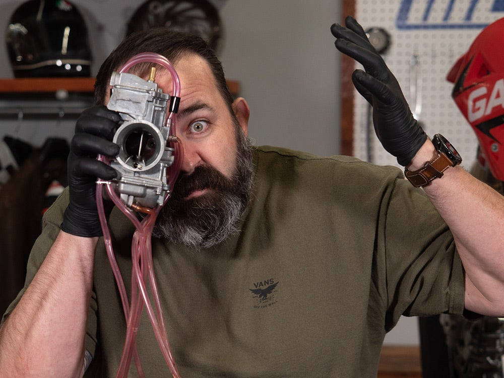 Jason Dawes with a carburetor