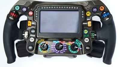 The steering wheel in an F1 race car requires fighter jet components and lots of practice