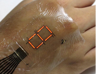 Flexible e-skin that has embedded polymer light emitting diodes