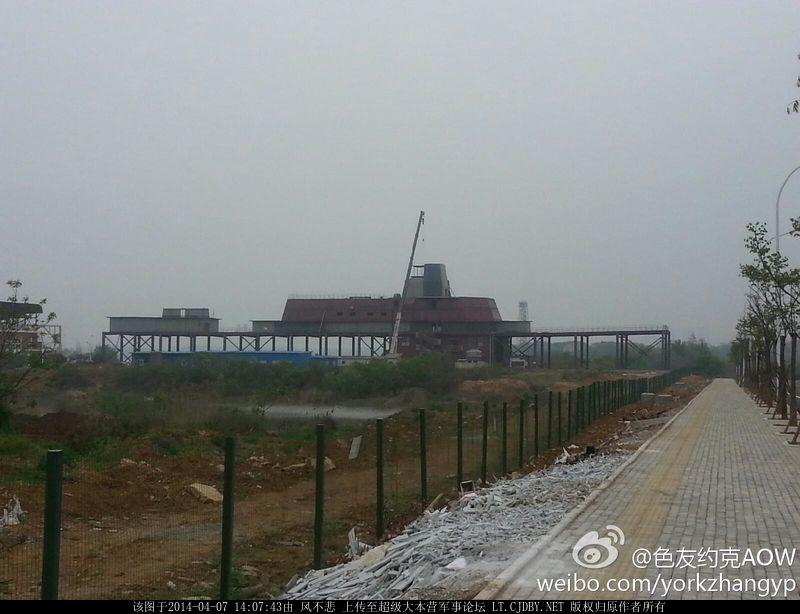 The next new major Chinese warship arrives, on land