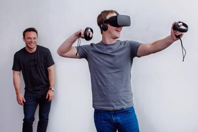 Mark Zuckerberg wears an Oculus Rift virtual reality headset
