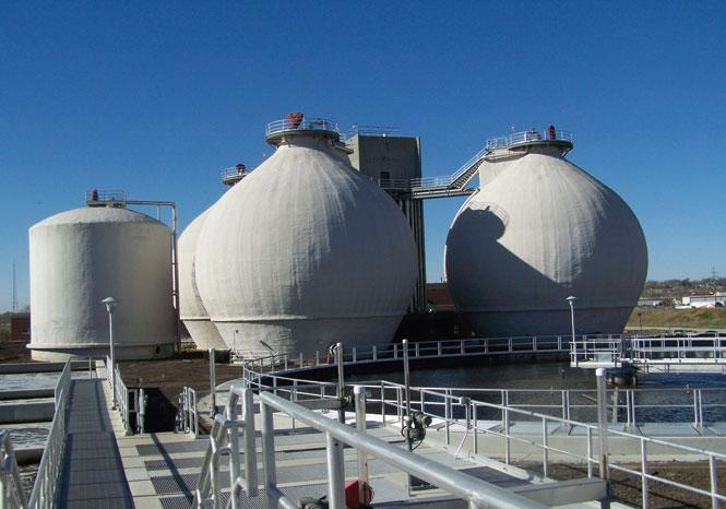 photo of large, round, white biogas plants