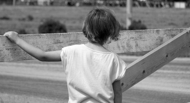 kid on fence