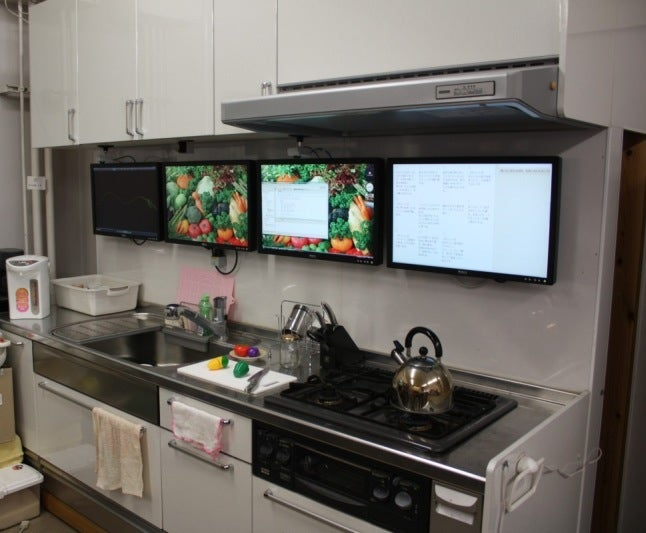 Dream Kitchens of the Future: Augmented Reality Countertops, Ingredient Sensors and Sous Chef Bots
