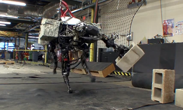 Watch BigDog, Our Favorite Four-Legged Military Robot, Hurl A Cinder Block