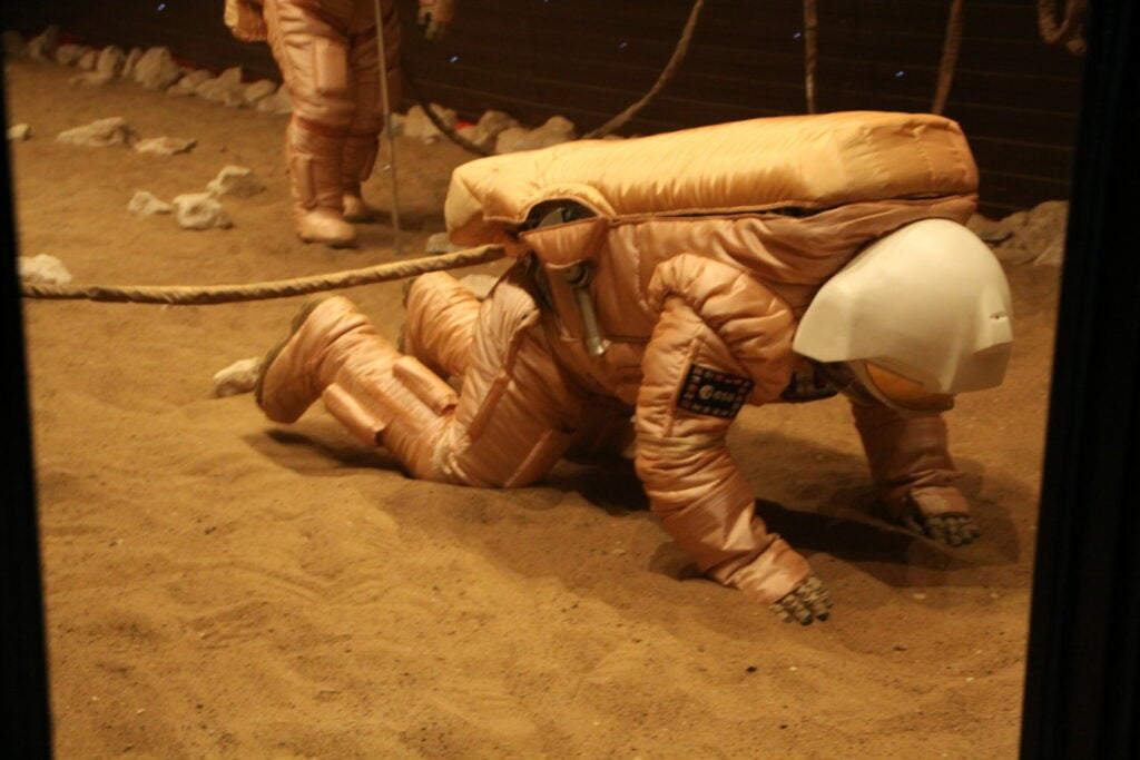 Diego Urbina tumbles over during the Mars simulation.