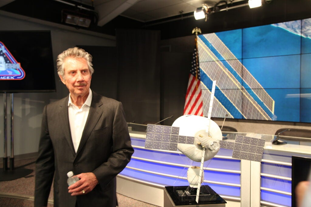 Robert Bigelow, owner of the Budget Suites hotel chain, stands next to a model of the inflatable habitat he hopes will one day lead to private space stations and space hotels.