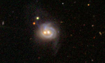Twin Supermassive Black Holes Found At Nearby Galaxy's Heart