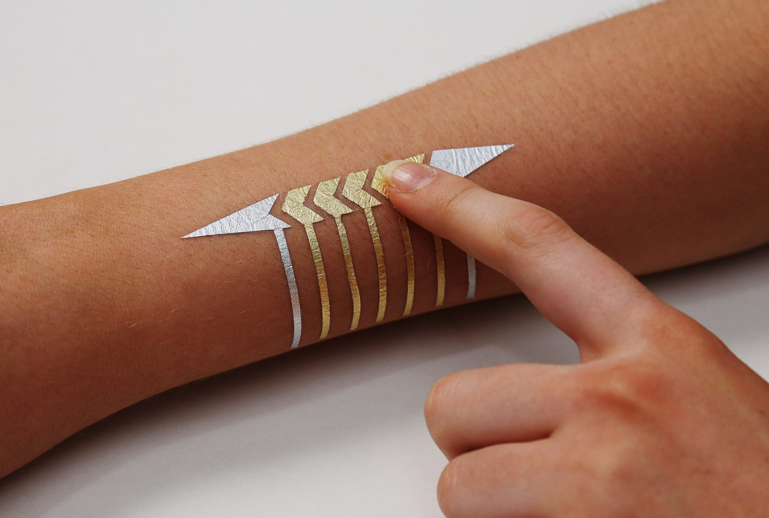 MIT Researchers Make Interactive Glowing Gold-Leaf Jewelry