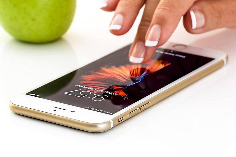 hand touching iPhone