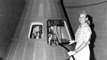 Jerrie Cobb poses next to a Mercury Capsule