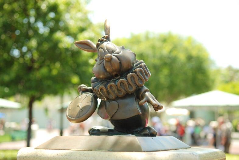 Disneyland bronze sculpture of white rabbit alice in wonderland