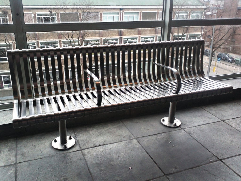 A bench in Rotterdam with arm rests designed to deter sleeping.