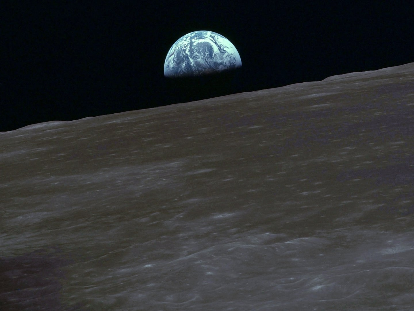 Earth rising over the moon during an Apollo mission