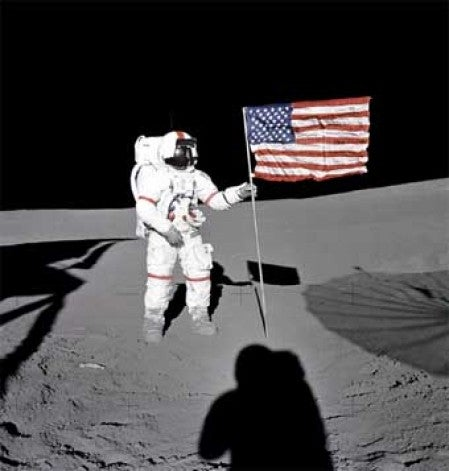 Al Shepard raises the American flag during Apollo 14
