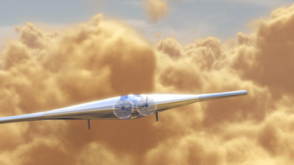 narrow sleek modern aircraft against yellow clouds