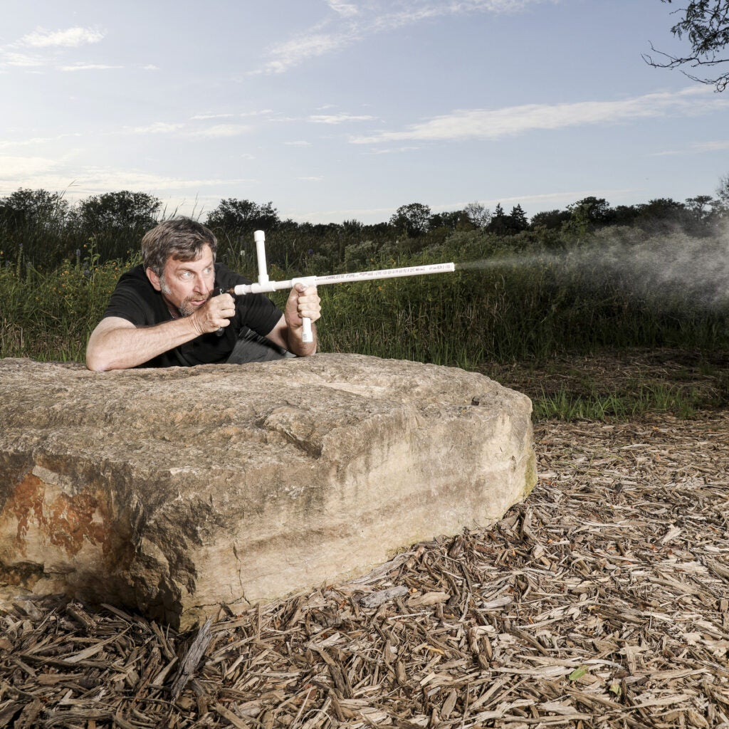 The author fires his gas-powered marshmallow shooter