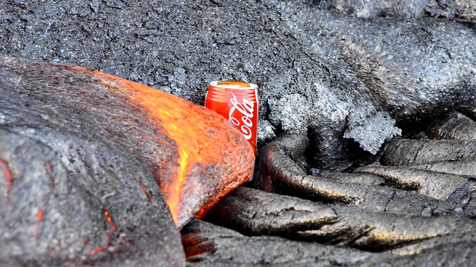 Why Can't I Look Away From This Lava Destroying A Coke Can?