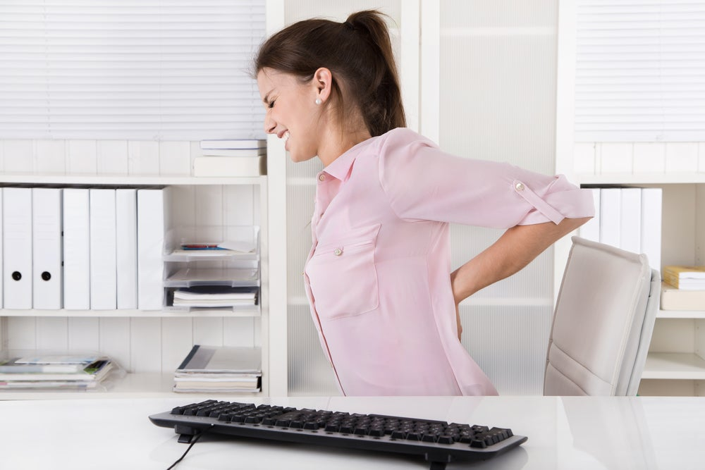 woman working with back pain
