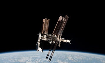 First-Ever Photos of Space Shuttle Docked At Space Station