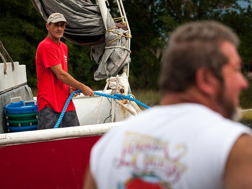 men in boats