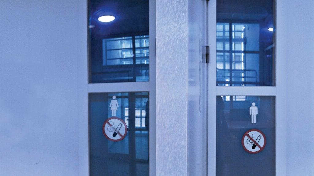 A bathroom with blue lights