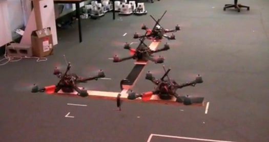 Video: UPenn's Amazing Quad-Rotor Drones Now Work in Teams to Lift Heavy Payloads Together