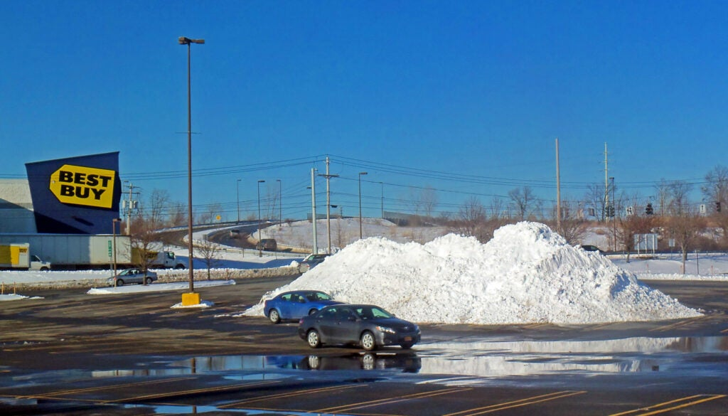 Snow piles left by plows in a WallKill, NY parking lot after a 2013 nor'easter.