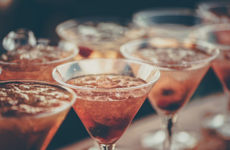 Pink alcoholic beverages in triangular glasses.