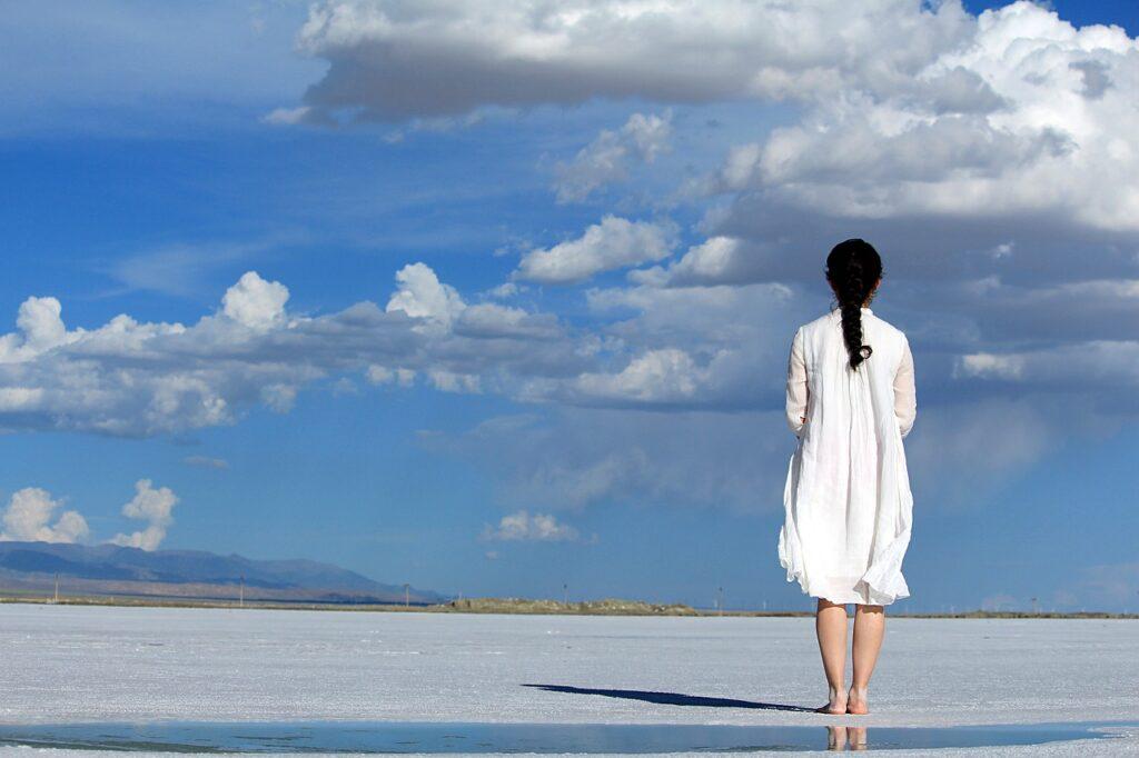 woman on sandy area blue sky