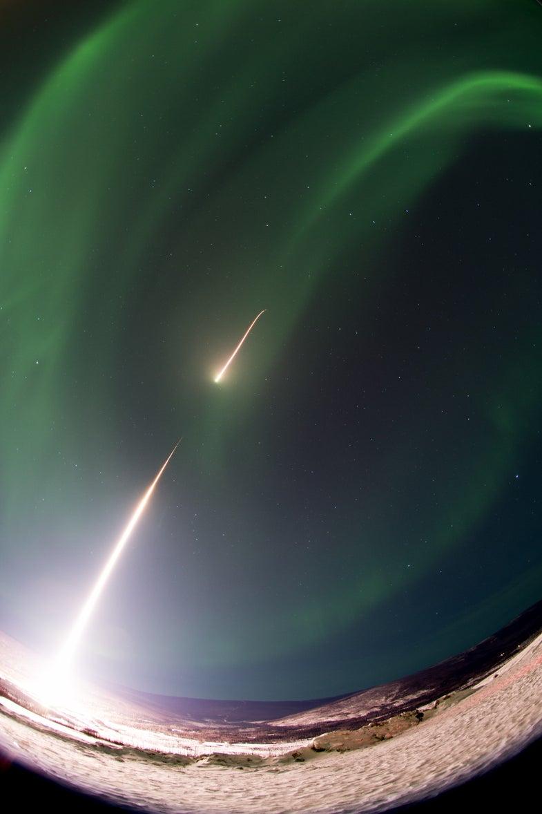 rockets going through the aurora borealis