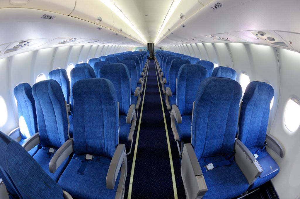 How Sneeze Particles Travel Inside An Airplane