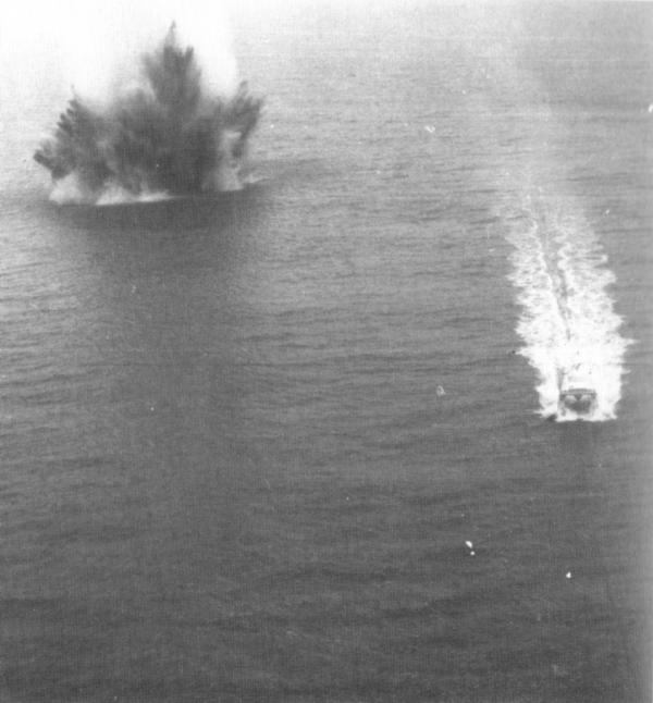 two explosions in water, in black and white