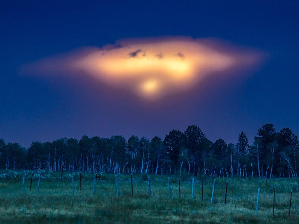 bright UFO in the night sky