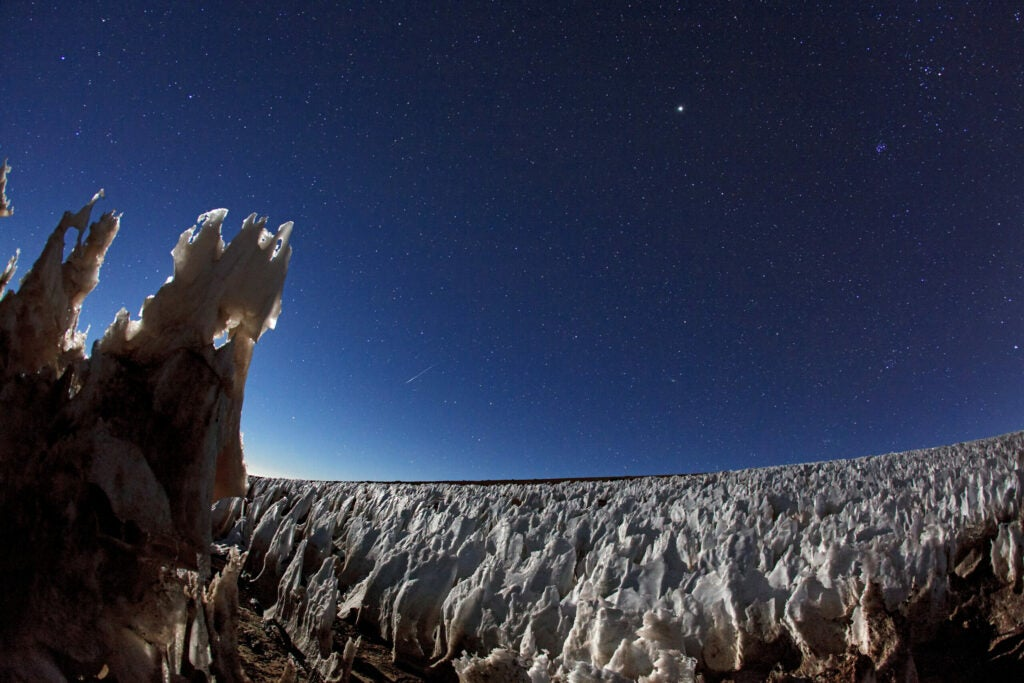 blades of snow and ice under a dark sky