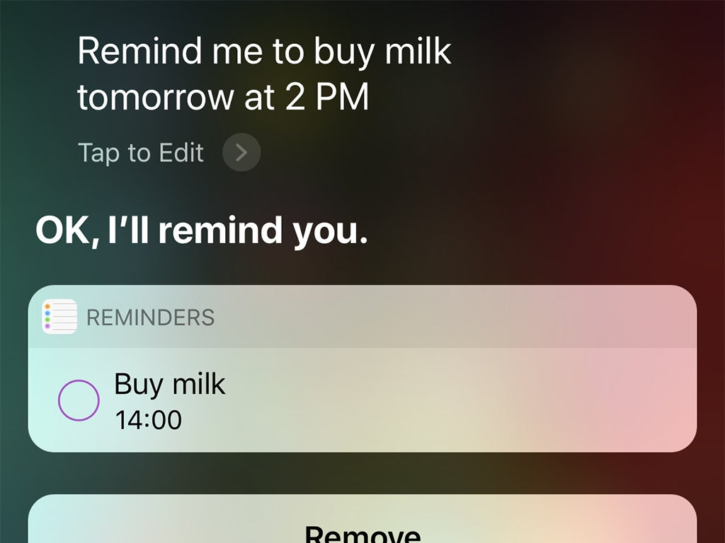 The iOS interface when you ask Siri to set a reminder to buy milk tomorrow at 2 p.m.