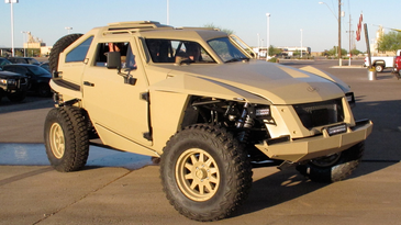 Military vehicle FLYPmode on a parking lot
