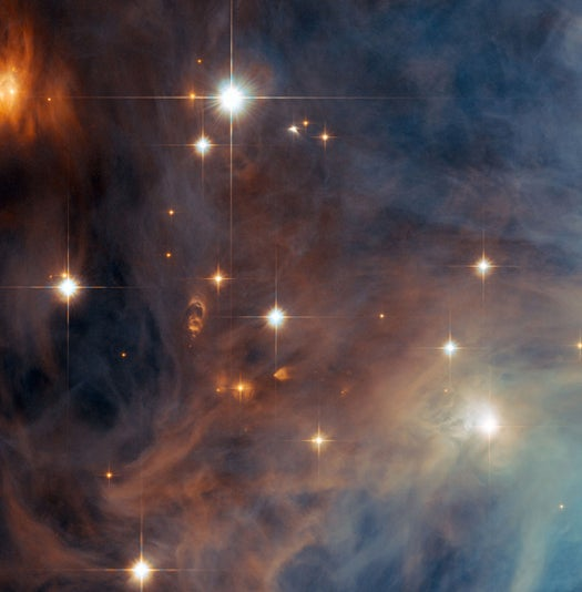 Hubble Captures the Orion Nebula's Little Brother Busily Birthing Stars