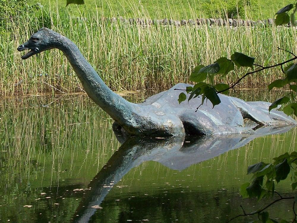 plastic loch-ness monster in water