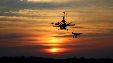 Drones flying toward the sun