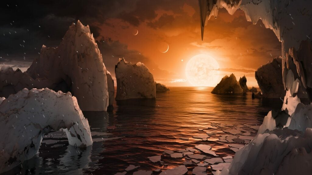 An artist imagines what the surface of TRAPPIST-1f may look like.